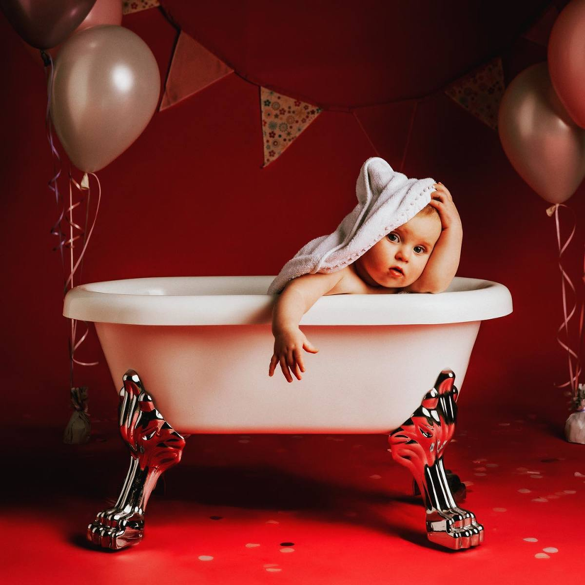 Baby in the Bath after a cake smash photo shoot