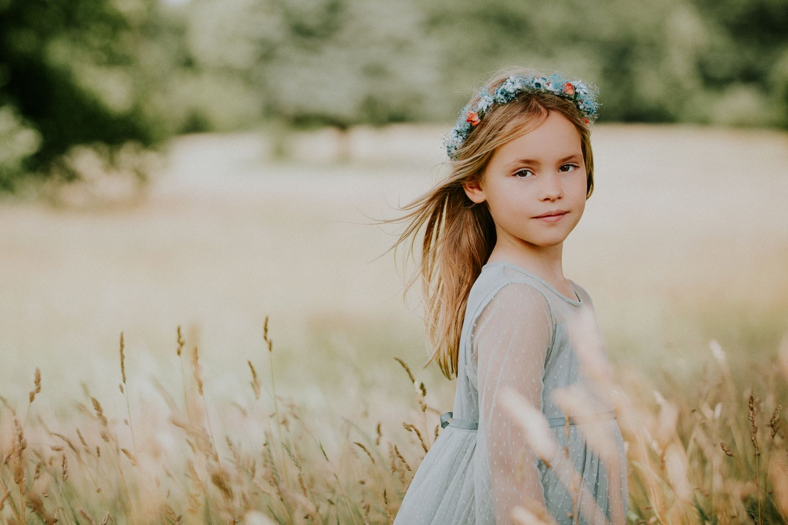 Young girl in field of long grass